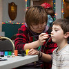 Aiden Staller, 7, gets a shooting star painted onto his face by Hatboro-Horsham student Elliot Chang. Chang joined other students in providing free face painting for the Willow Grove VFW Post 3612's annual Children's Christmas Party Dec. 18.  Rachel Wisniewski — For Digital First Media