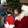Chris Grossback and his sons meet with Santa at the Perkasie Fire Company's Breakfast with Santa Sunday, Dec. 18.  Debby High — For Digital First Media