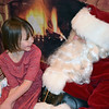 Stephanie Pate, 5, meets Santa during the Perkasie Fire Company's Breakfast with Santa Sunday, Dec. 18. Debby High — For Digital First Media