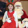 Lauren McGurk visits Santa at the Perkasie Fire Company's Breakfast with Santa Sunday, Dec. 18.  Debby High — For Digital First Media