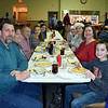 The Klein and Trotter families eat together at the Perkasie Fire Company's Breakfast with Santa Sunday, Dec. 18.  Debby High — For Digital First Media