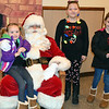 Cousins Mia Barlow, Bella Stanish and Bristol Barlow met Santa at the Perkasie Fire Company's Breakfast with Santa Sunday, Dec. 18.  Debby High — For Digital First Media