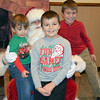 Rocko, Luke and Bode Derkacs, of Chalfont, enjoy the Perkasie Fire Company's Breakfast with Santa Sunday, Dec. 18.  Debby High — For Digital First Media