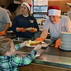 Perkasie firefighters serve up food at the company's annual Breakfast with Santa Sunday, Dec. 18.  Debby High — For Digital First Media