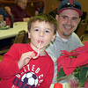 Coen Towle and his dad, Dan, enjoy the Perkasie Fire Company's Breakfast with Santa Sunday, Dec. 18.  Debby High — For Digital First Media