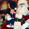 Three-month-old Finnegan High meets Santa for the first time at the Perkasie Fire Company's Breakfast with Santa Sunday, Dec. 18.  Debby High — For Digital First Media