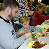 Matt Renner and his son, Trend, eat at the Perkasie Fire Company's Breakfast with Santa Sunday, Dec. 18.  Debby High — For Digital First Media