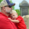 Debby High — For Digital First Media<br /> Mason Rivet stays close in his grandpa's arms during the National Bell Ringing Ceremony held at the Sellersville Museum on the Fourth of July.