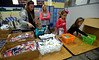 Jennifer Swansen, left, Carly Swansen, Naina Rastoggi-Wilson and Carmyn Swansen put together Little Lunch Boxes during the Giving Tree Working Hands event at Wissahickon Middle School Nov. 12, 2016.   |  Bob Raines--Digital First Media