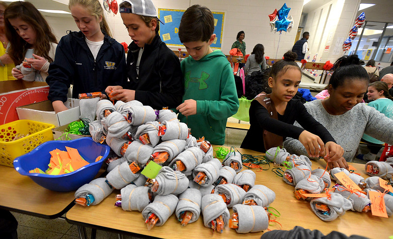 Volunteers roll up snacks in pairs of socks during the Giving Tree Working Hands event at Wissahickon Middle School Nov. 12, 2016.   |  Bob Raines--Digital First Media