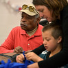Gerald Faust, left, knots tassles at the end of a fleece scarf during the Giving Tree Working Hands event at Wissahickon Middle School Nov. 12, 2016.   |  Bob Raines--Digital First Media