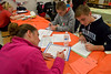 Sarah Galbreath and her sons, Gregory and Jack, write letters and cards to U.S. service personnel during the Giving Tree Working Hands event at Wissahickon Middle School Nov. 12, 2016.   |  Bob Raines--Digital First Media