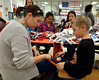 Kristen and Billy Campbell braid dog toys during the Giving Tree Working Hands event at Wissahickon Middle School Nov. 12, 2016.   |  Bob Raines--Digital First Media