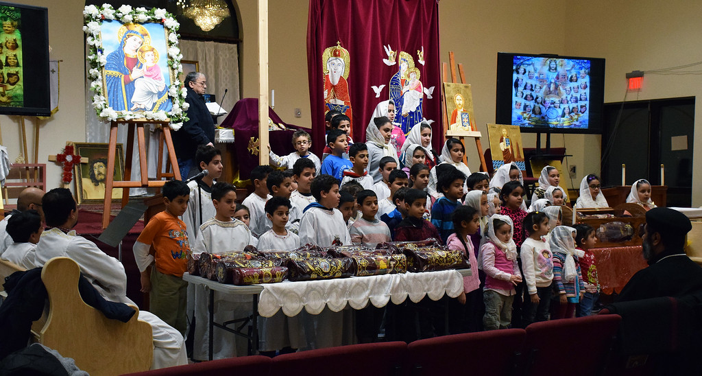 . Monday night young voices sang during the prayer vigil held at St. Mary & St. Kyrillos Coptic Orthodox Church.  Debby High for Digital First Media