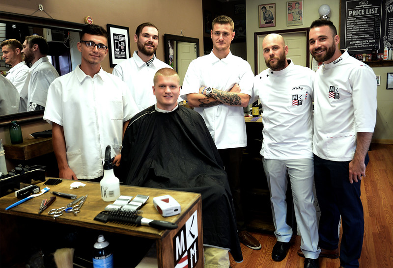 Nick Prosseda, second from right, with his barber trainees and a customer in his Sellersville training center July 26, 2016. | BOB RAINES--DIGITAL FIRST MEDIA