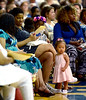 A little girl wanders in front of a row of Cheltenham High School family members watching commencement at La Salle University June 16, 2016. Her mom is only an arm's length away.__ BOB RAINES / DIGITAL FIRST MEDIA