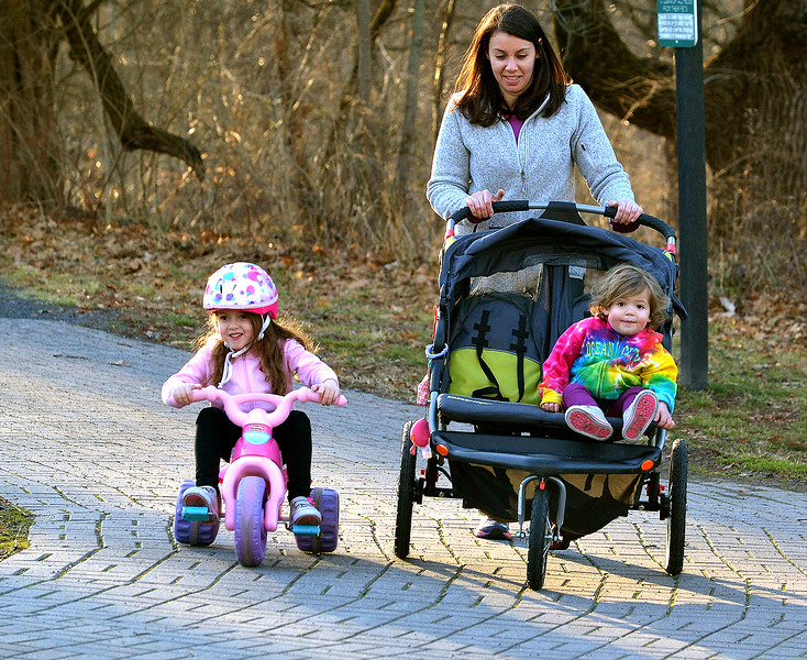 Brooke Parker and her daughters, Hillary, left, and Hannah walk along the trail following the Towamencin Creek at Fischer's Park, Harleysville Jan. 25, 2017.  (Bob Raines--Digital First Media)