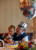Henry Newman hugs his youngest great grandchild, Declan Leahy, during his 100th birthday party at Elm Terrance Gardens, Lansdale Jan. 21, 2017.(Bob Raines--Digital First Media)