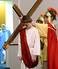 A Roman soldier lays the cross on Jesus' shoulder during the Living Stations of the Cross at Visitation BVM Church, Norristown Mar. 25, 2016. // Bob Raines--Digital First Media