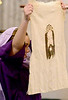 Veronica (Sarah Murphy) holds up the cloth with which she wiped the face of Jesus  as fifth-graders perform the Living Stations of the Cross at Visitation BVM Church, Norristown, Mar. 24, 2016. // Bob Raines--Digital First Media