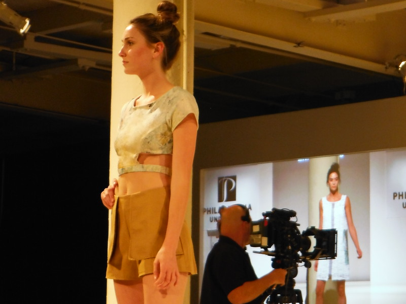 Mustard shorts with cutout crop top by Emily Balins modeled at the Philadelphia University Fashion Show April 21 at Moulin in East Falls. Eric Fitzsimmons — Digital First Media