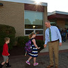 Guth Elementary Principal Matt Smith welcomes students and families on the first day of school Monday, Aug. 29.  Debby High — For Digital First Media