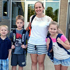 Debby High — For Digital First Media<br /> Tracy Lukas and her children, Matthew, Jesse and Julia, pose just before the first day of school at Guth Elementary Monday, Aug. 29.
