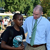 Debby High — For Digital First Media<br /> Principal Matt Smith welcomes fifth-grader Michael Muiruri on the first day of school at Guth Elementary Monday, Aug. 29.