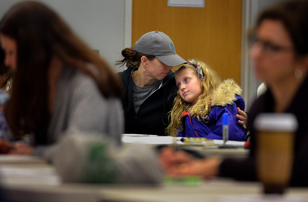 . Sarah Keller hugs her daughter, Audrey, as they attend a training and sign making session at the Wissahickon Valley Public Library in Blue Bell Jan. 14, 2017 before the Women\'s March on Washington.  (Bob Raines--Digital First Media)