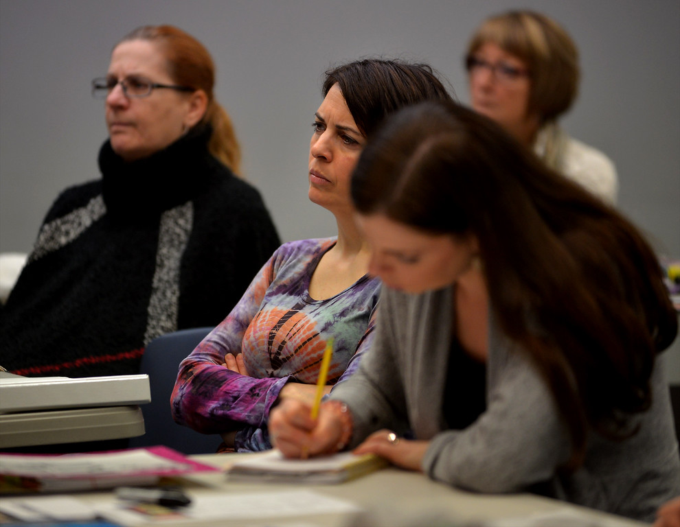 . Gina Donato listens to speaker Diane Williams at a training and sign making session at the Wissahickon Valley Public Library in Blue Bell Jan. 14, 2017 before the Women\'s March on Washington.  (Bob Raines--Digital First Media)