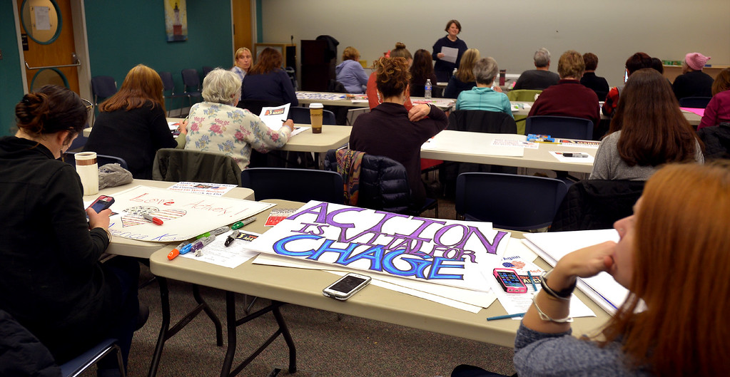 . Montgomery County women gather at the Wissahickon Valley Public Library in Blue Bell Jan. 14, 2017 for a training and sign making session before the Women\'s March on Washington.  (Bob Raines--Digital First Media)