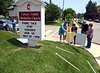 Members of Ambler Area Coalition for Peace and Calvary United Methodist Church erect a memorial on the church lawn to Montgomery County victims of gun violence May 26, 2016. / BOB RAINES--DIGITAL FIRST MEDIA