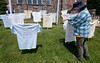 Diane Morgan, right, and other members of Ambler Area Coalition for Peace and Calvary United Methodist Church, Ambler, erect a memorial May 26, 2016 to victims of gun violence. / BOB RAINES--DIGITAL FIRST MEDIA