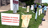 Members of Ambler Area Coalition for Peace and Calvary United Methodist Church erect a memorial on the church lawn May 26, 2016 to Montgomery County victims of gun violence.  / BOB RAINES--DIGITAL FIRST MEDIA