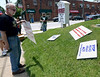Pastor Gary Lefever, left, and members of Calvary United Methodist Church, Ambler, along with members of Ambler Area Coalition for Peace erect a memorial on the church lawn to Montgomery County victims of gun violence May 26, 2016. / BOB RAINES--DIGITAL FIRST MEDIA