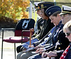 At the end of the row of government officials and retired military officers is an empty chair for those service personnel who didn't return.   |   Bob Raines--Digital First Media