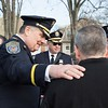 Outside the church, Abington police chief William Kelly places a comforting hand on the shoulder of a service attendee. Kelly attended the service with his wife, the deputy chief, and several other officers. Rachel Wisniewski — For Digital First Media