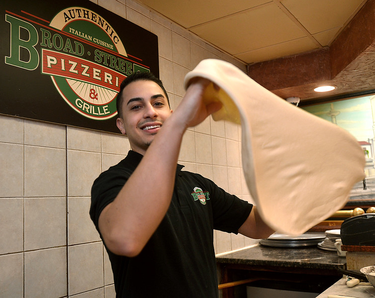 Owner Davide Sowhanger tosses a pizza crust at Broad St. Pizzeria & Grille, Souderton Feb. 7, 2017.  (Bob Raines--Digital First Media)