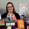Sara Jozwik, independent contractor for Usborne Books, takes part in the Pop Up Shop at Per Diem in Perkasie Saturday, Feb. 18.  Debby High — For Digital First Media