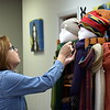 A merchant prepares her display for shoppers at the Pop Up Shop at Per Diem in Perkasie Saturday, Feb. 18.  Debby High — For Digital First Media