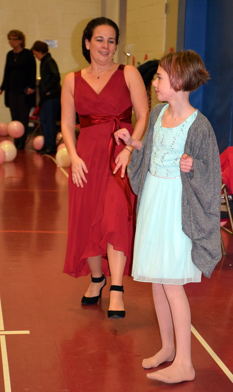 . Tina Cook, sports director of the Indian Valley Family YMCA, helps her niece, Adle, learn some dance steps during the Daddy Daughter Dance at the Indian Valley Family YMCA Saturday, Feb. 11.  Debby High � For Digital First Media