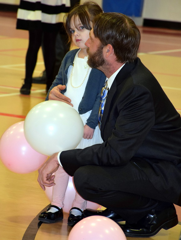 . Michael and Kaya Sturgeon take a break from dancing during the Daddy Daughter Dance at the Indian Valley Family YMCA Saturday, Feb. 11.  Debby High � For Digital First Media
