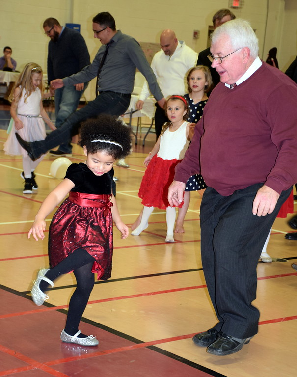 . Dave Edward dances with his granddaughter, Caeleight Wright, during the Daddy Daughter Dance at the Indian Valley Family YMCA Saturday, Feb. 11.  Debby High � For Digital First Media