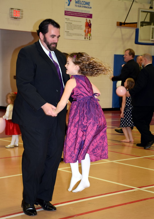 . Fathers hit the dance floor with their daughters during the Daddy Daughter Dance at the Indian Valley Family YMCA Saturday, Feb. 11.  Debby High � For Digital First Media
