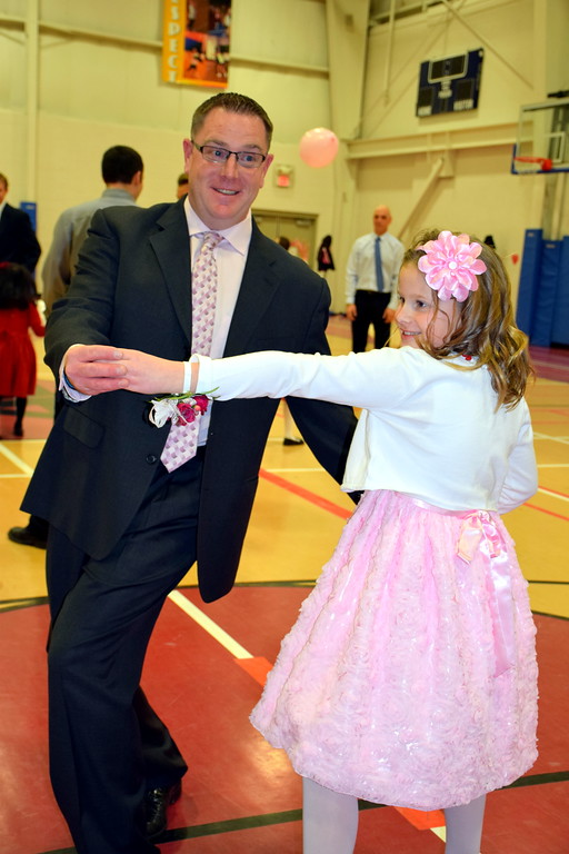 . Steve and Kayla Arnold, of Skippack, dance during the Daddy Daughter Dance at the Indian Valley Family YMCA Saturday, Feb. 11.  Debby High � For Digital First Media