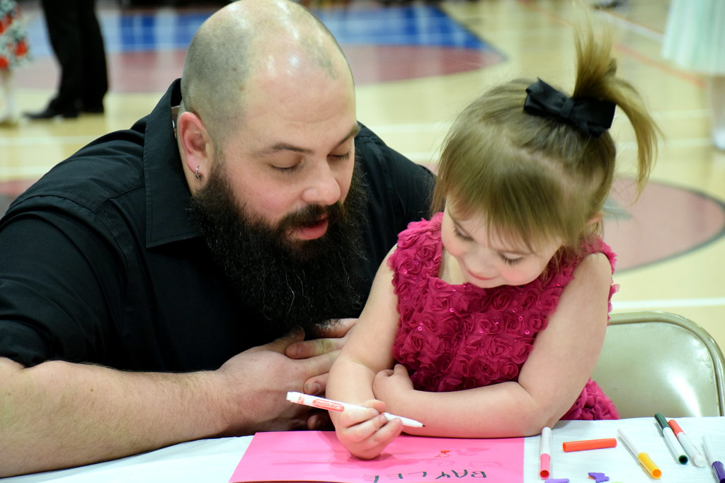 . Gordon and Baylee Porterfield enjoy arts and crafts during the Daddy Daughter Dance at the Indian Valley Family YMCA Saturday, Feb. 11.  Debby High � For Digital First Media