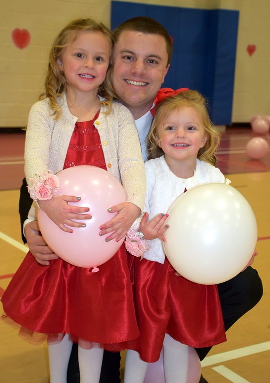 . Megan with her dad, Tim Kolesar, dance during the Daddy Daughter Dance at the Indian Valley Family YMCA Saturday, Feb. 11.  Debby High � For Digital First Media