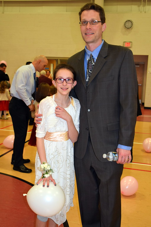 . Mike and Zoe Morawski, of Lansdale, enjoy the Daddy Daughter Dance at the Indian Valley Family YMCA Saturday, Feb. 11.  Debby High � For Digital First Media
