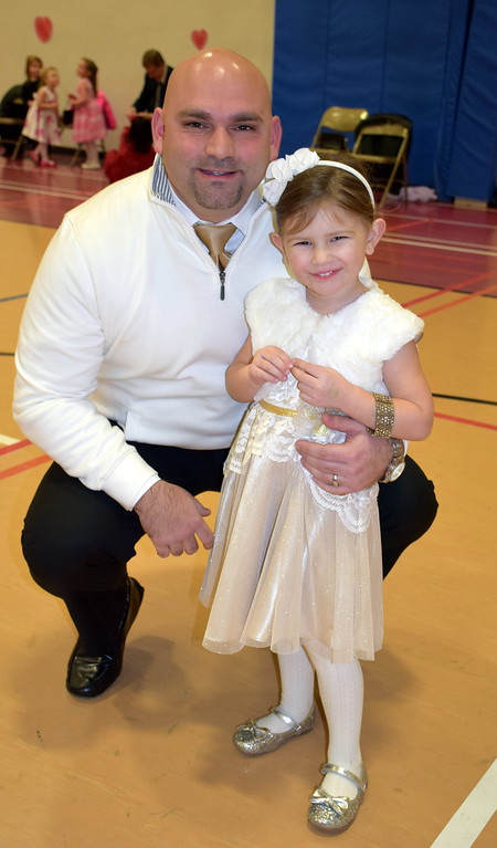. Christos and his daughter, Elaini Charitos, of Hatfield, enjoy the Daddy Daughter Dance at the Indian Valley Family YMCA Saturday, Feb. 11.  Debby High � For Digital First Media