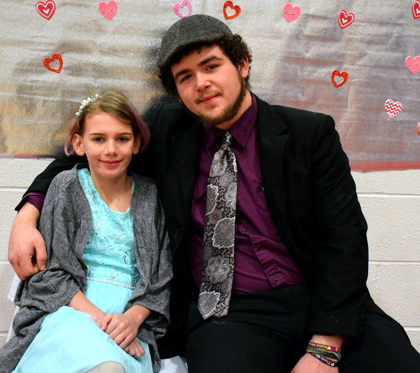 . Adle is escorted by her cousin, Marc, as her date for the night during the Daddy Daughter Dance at the Indian Valley Family YMCA Saturday, Feb. 11.  Debby High � For Digital First Media